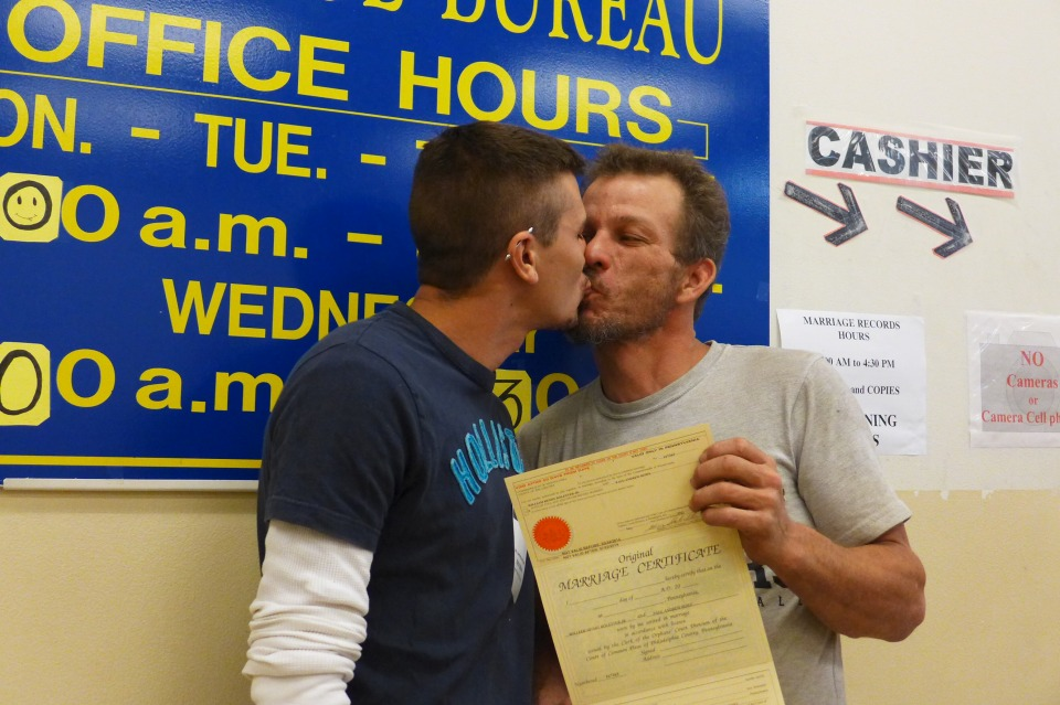 Philadelphia William and Paul kiss and hold up marriage license
